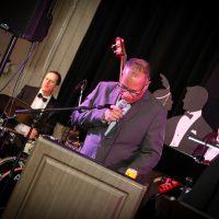 Derek Hines at the mic.  Photo Credit: Cameron Shaver