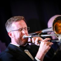 Robin Jessome, trombone and conductor.  Photo credit: Cameron Shaver